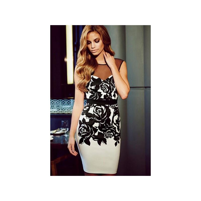 e67c1ca6956 La robe à fleurs noire et blanches sur Bustiers et Corsets