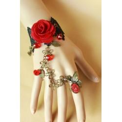 Le bijou de main rouge